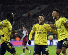 Gabriel Martinelli celebrates with Aubameyang and Pepe after scoring against West Ham